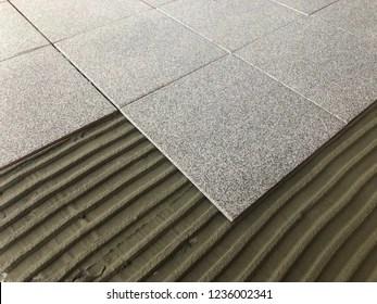 https www shutterstock com image photo installing ceramic floor tile new construction 1236002341