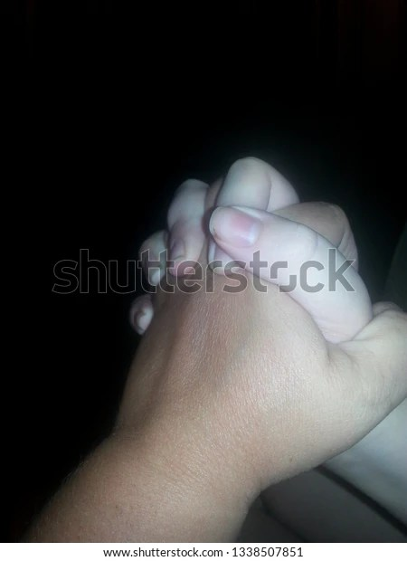 isolated photo of two people holding hands