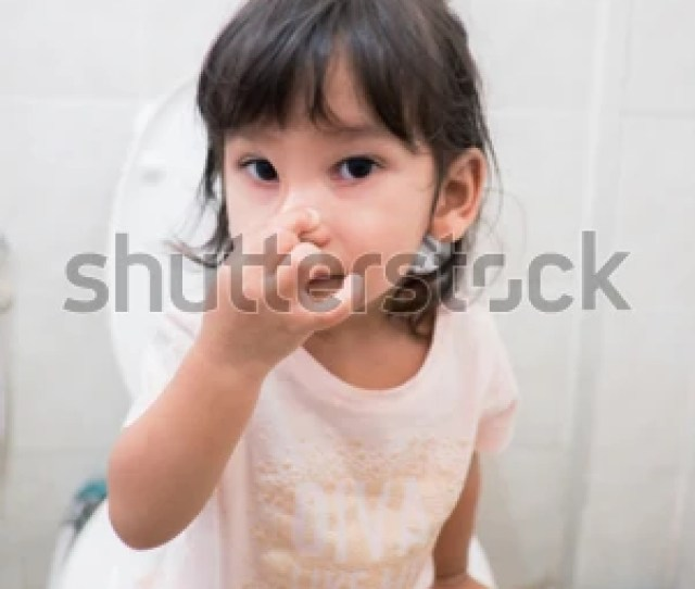 Little Asian Girl Sitting On A Toilettraining Child Concept Little Girl Poo And