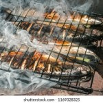 Ocean Smoke Images  Stock Photos   Vectors   Shutterstock Mackerel fish grilled on iron plate in rural house fireplace closeup with  white smoke