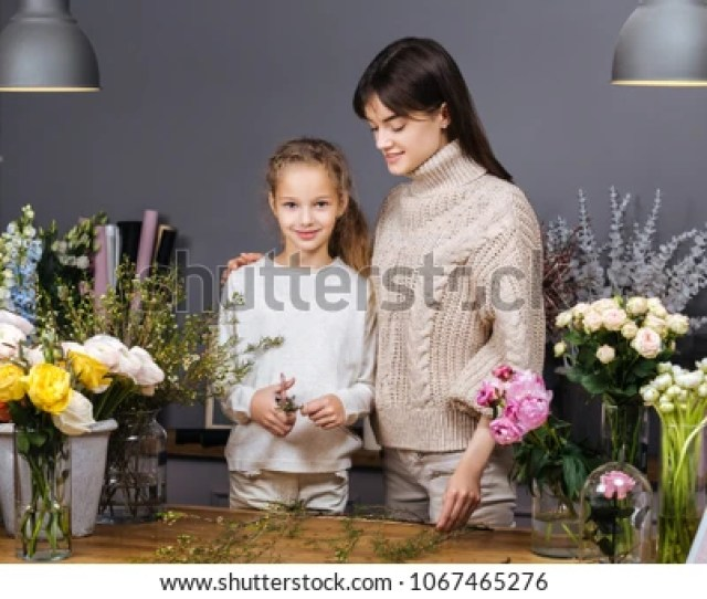 Mom Teaches Her Daughter To Take Care Of Flowers Family Business