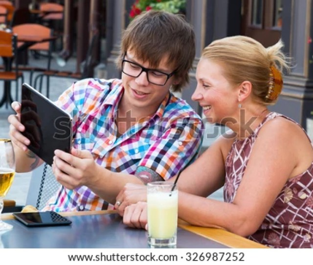 Mom Teaches Son To Use Tablet