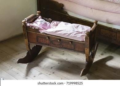 https www shutterstock com image photo old wooden rocking bed baby duvet 719998525