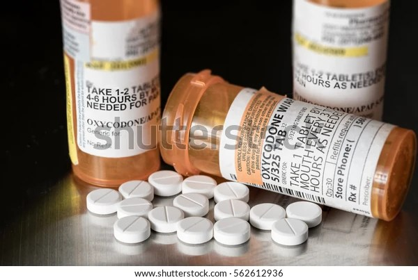 Macro close up shot of oxycodone tablets to illustrate opioid epidemic in the USA