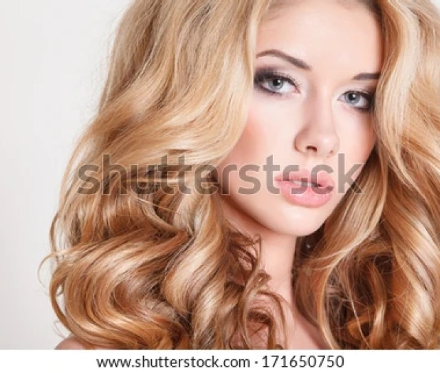 Portrait Of Beautiful Blonde Woman With Curly Hairstyle And Bright Makeup Perfect Skin Skincare