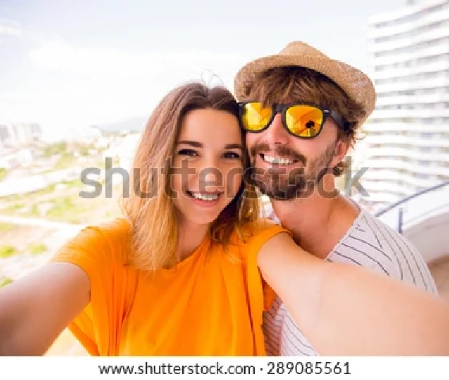 Pretty Girl With Handsome Boyfriend Making Self And Have Fun Together On The Balcony Amazing View