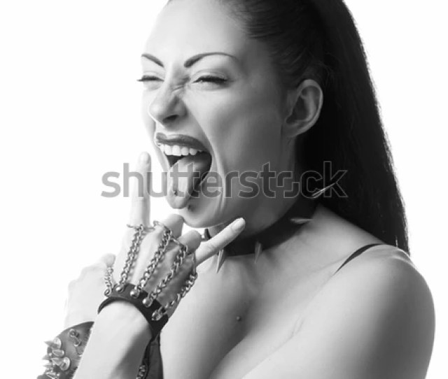 Rocker Heavy Metal Girl With Piercing Tongue Making Horns Sign Isolated On White Background
