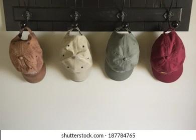 https www shutterstock com image photo several caps hang on hooks near 187784765