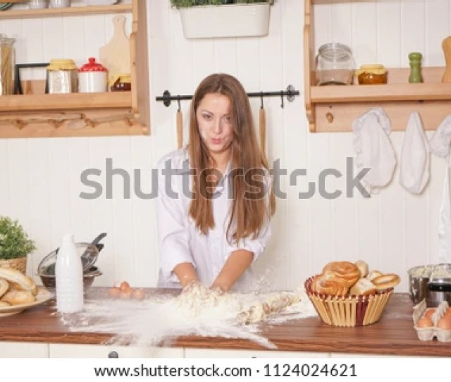 Sexy Chubby Housewife In White Lingerie And Mens Shirt On Top Prepares Food In The Kitchen