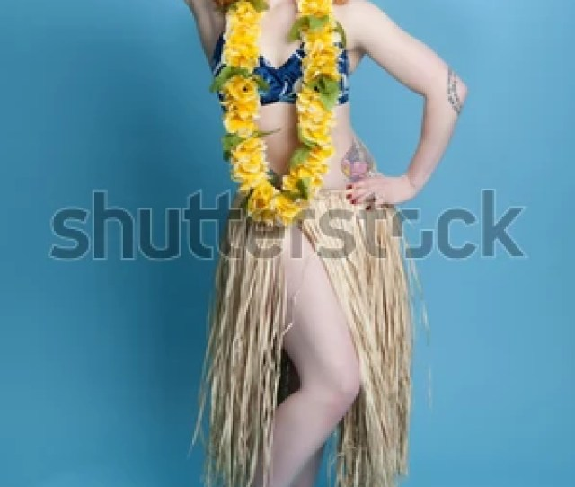 Sexy Hula Pinup Model With Grass Skirt Dancing The Hula