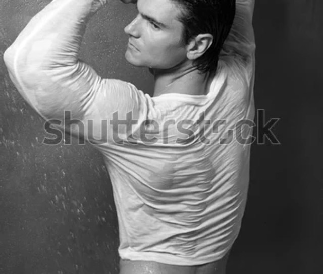 The Sexy Man Is Taking A Shower With Clothing On