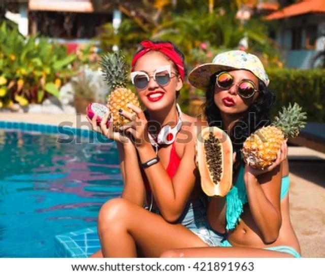 Sexy Teen Girls Tanningwearing Glamor Sunglasses Eating Fresh Fruits Outdoor Sensual Lips