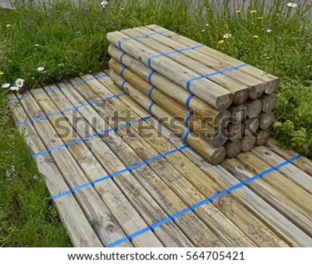 Small Garden Idea Of Decking With Matching Timber Seating