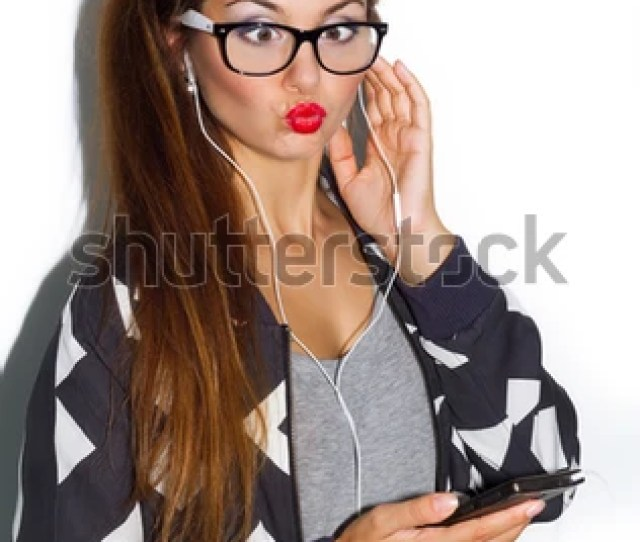 Teenage Girl Listening Music On Mobile On White Background Close Up Funny Portrait Of Sexy