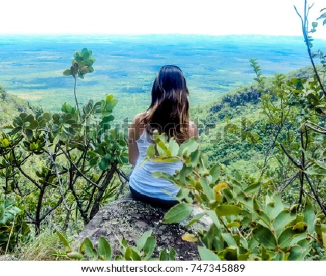 Woman Enjoying The Scenery At The Top Of The Hill Chapada Dos Veadeiros Goias