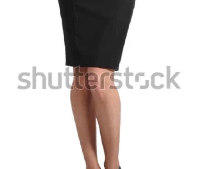 Woman Legs With Nylons And Pencil Skirt Isolated On A White Background
