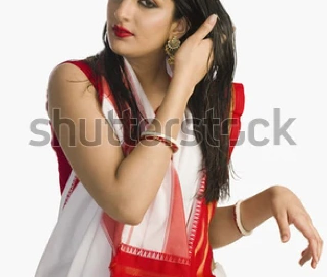 Woman In Traditional Bengali Saree With Her Hand In Her Hair