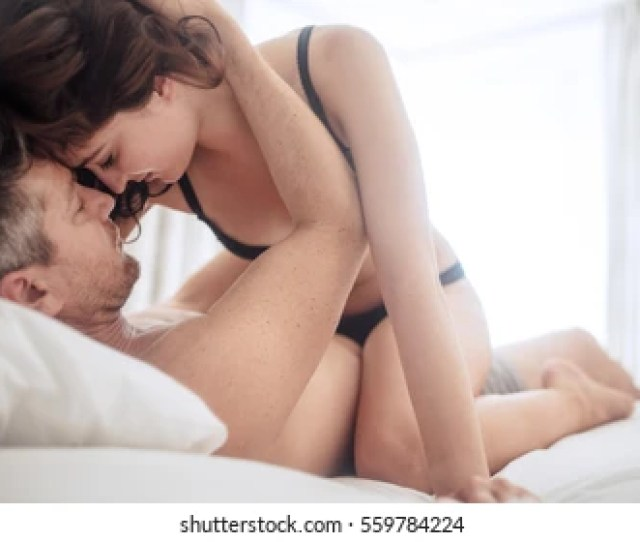 Young Beautiful Sexy Woman Lying On Her Man While Having Sex Passionate Couple Making Love