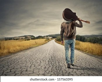 Young Man Walking With Guitar Images Stock Photos Vectors