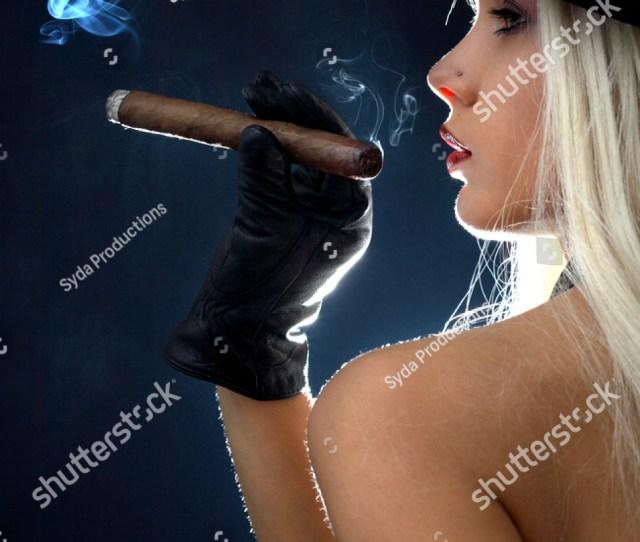 Backlight Image Of Topless Girl Smoking Cigar