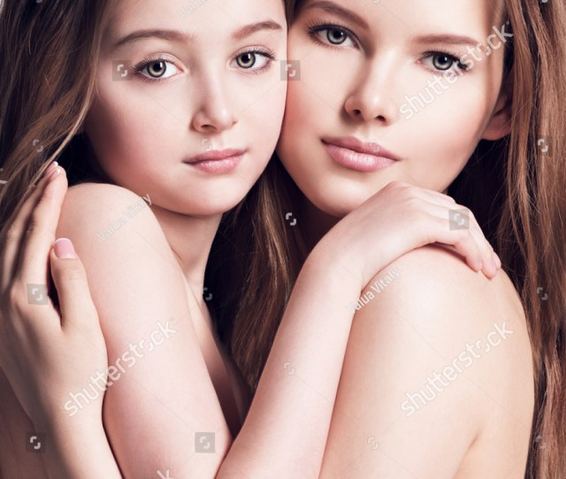 Beautiful Naked Mother And Small Daughter 8 Years With Long Brown Hair Embrace Each Other At