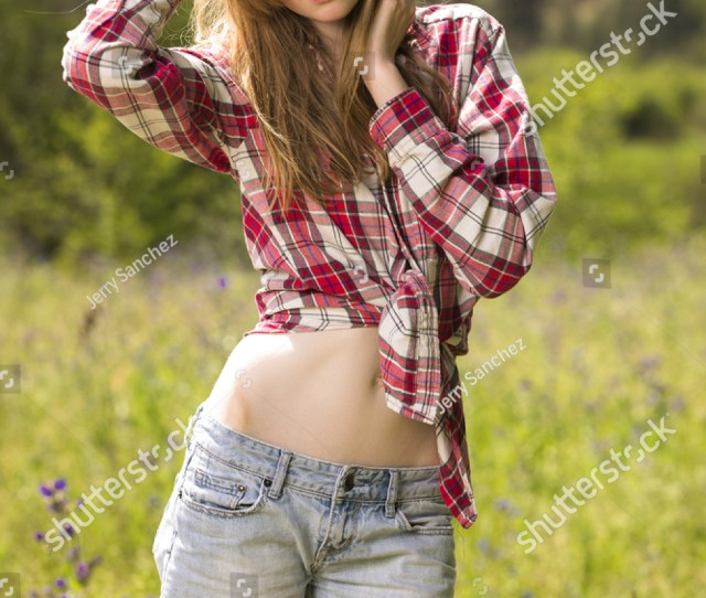 Beautiful Young American Teen Girl In Western Wear Posing Outdoors