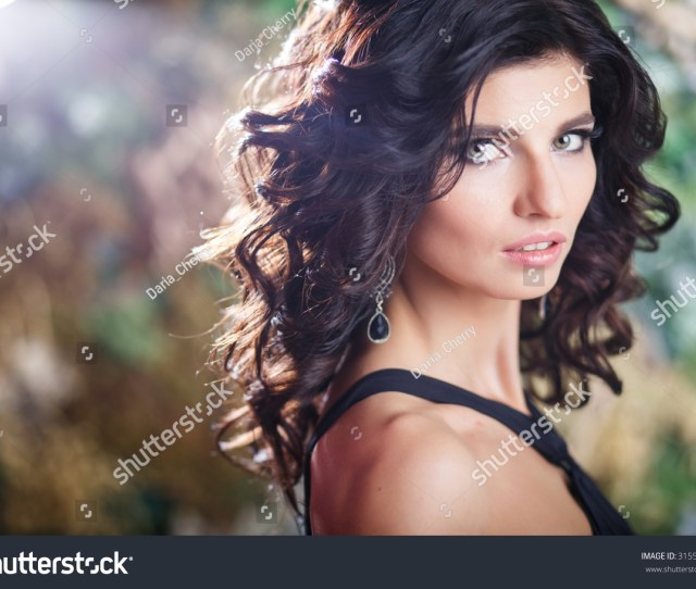 Close Up Beauty Portrait Of Gorgeous Brunette Woman With Perfect Makeup And Hairstyle