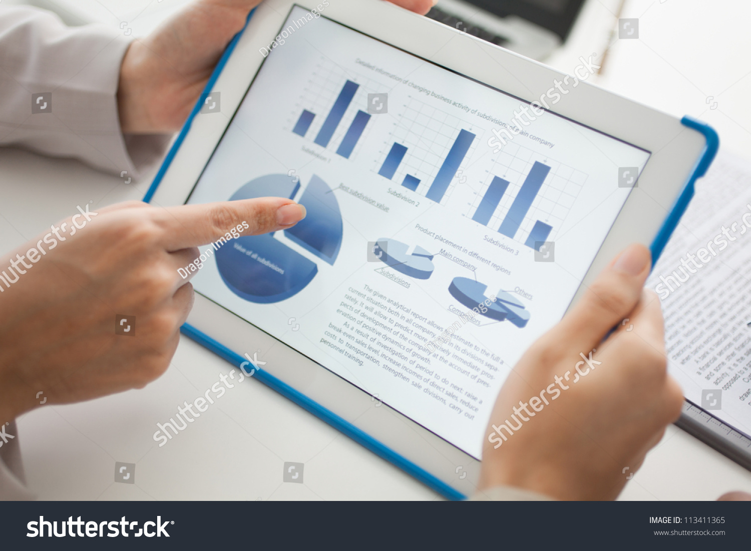 Close Up Of A Touchscreen With Financial Data In Form Of Charts And Diagrams Stock Photo
