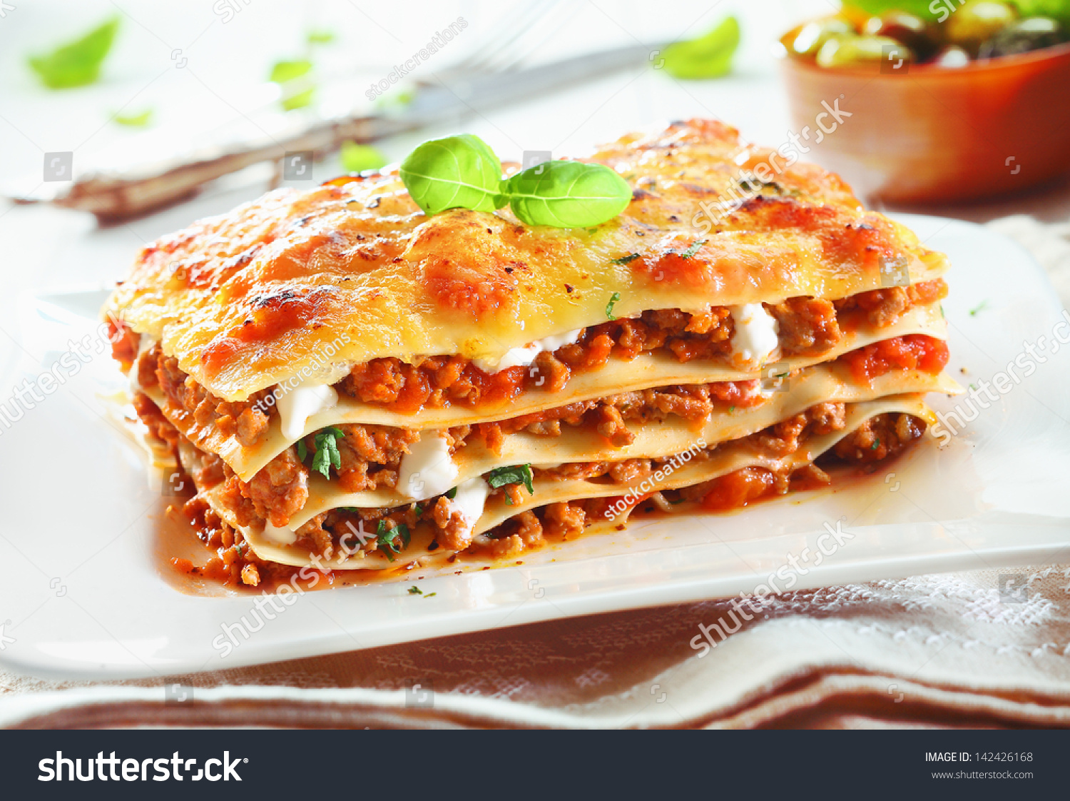 Close-Up Of A Traditional Lasagna Made With Minced Beef Bolognese Sauce Topped With Basil Leafs Served On A White Plate Stock Photo 142426168 ...