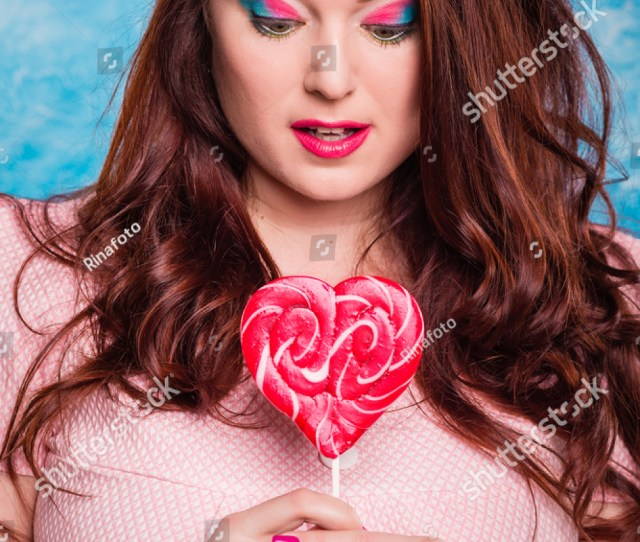 Close Up Plump Fat Plus Size Redhead Woman With Long Hair Curly With Bright