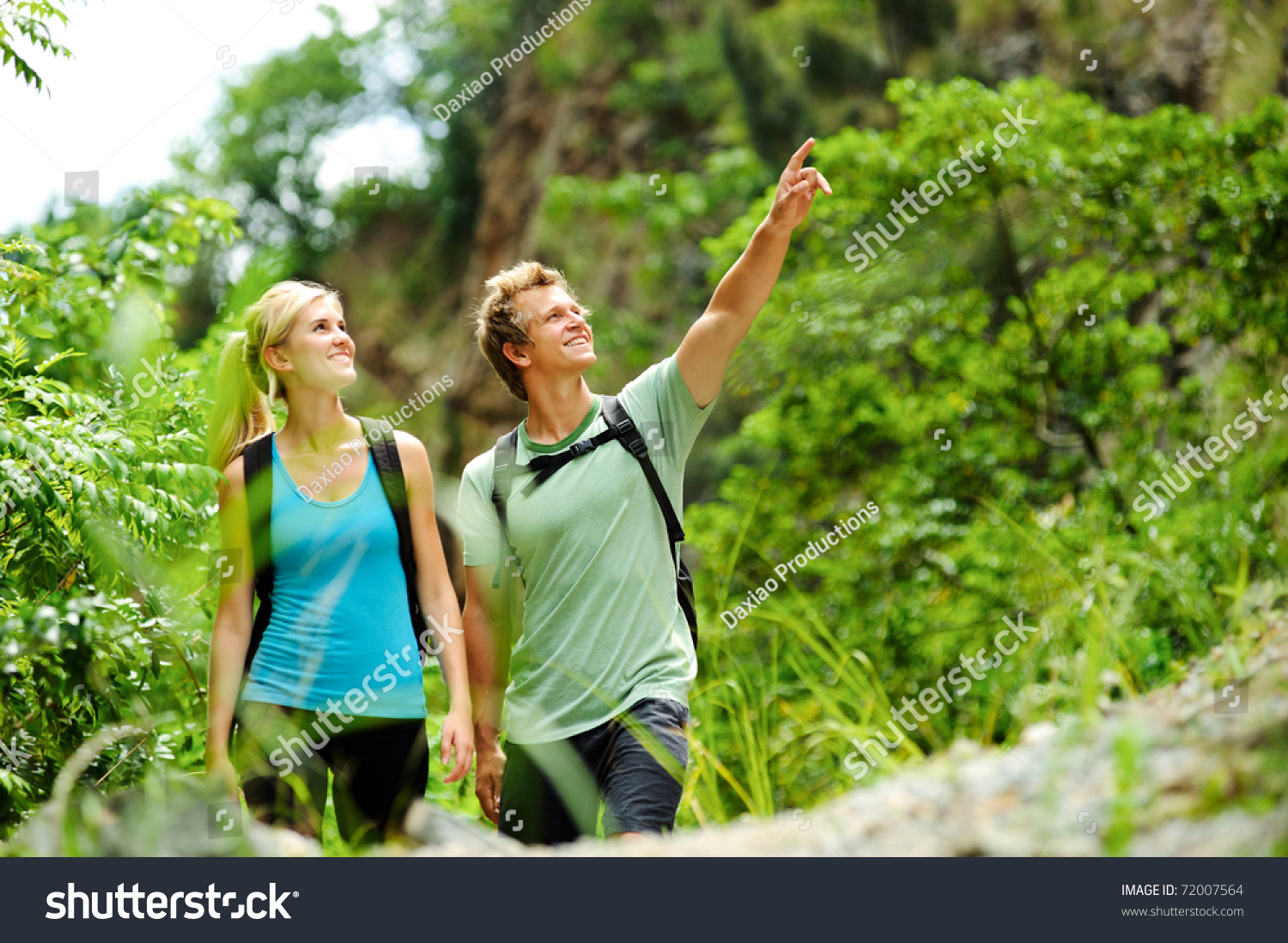 Cute Couple Have Fun Together Outdoors On A Hike Stock