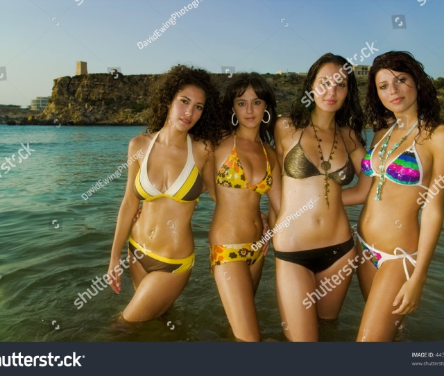 Four Gorgeous Young Girls Relaxing By The Ocean During A Hot Summers Day In Malta In
