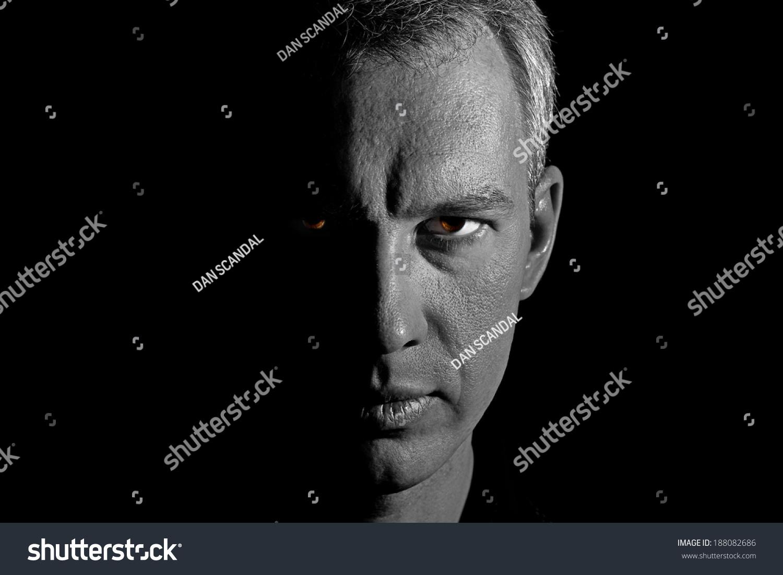 Halfface Mans Portrait Against Black Background Stock