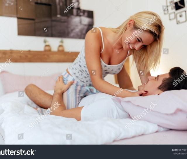Happy Couple In Bedroom Enjoying Sensual Foreplay