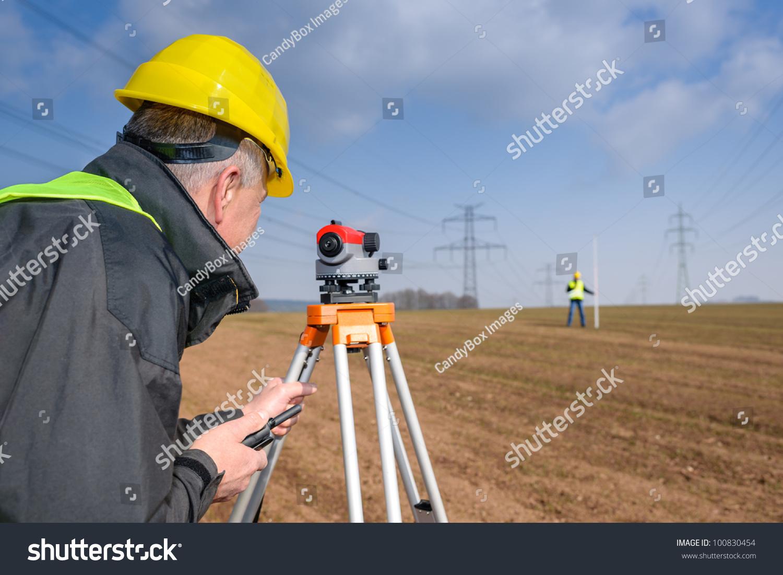 Land Surveyors Measuring Tacheometer Speaking Through Stock Photo