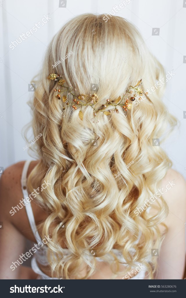 long blonde curly hair tender wedding stock photo (edit now