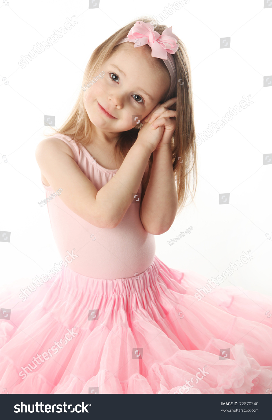 Portrait Of An Adorable Preschool Age Girl Playing Dress