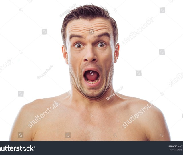 Portrait Of Handsome Naked Man Looking At Camera And Showing Surprise Isolated On A White