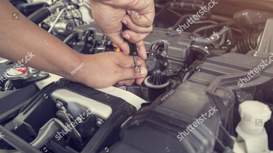 Professional Car Mechanic Working Auto Repair Stock Photo