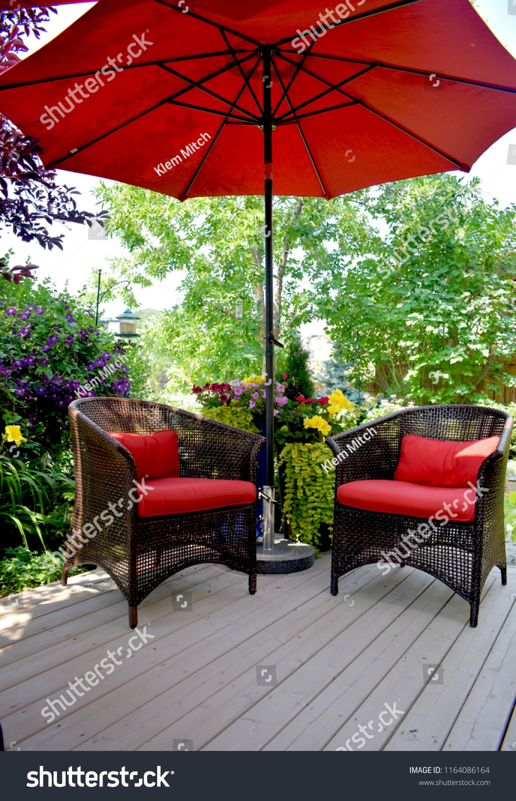 https www shutterstock com image photo red patio furniture under umbrella on 1164086164