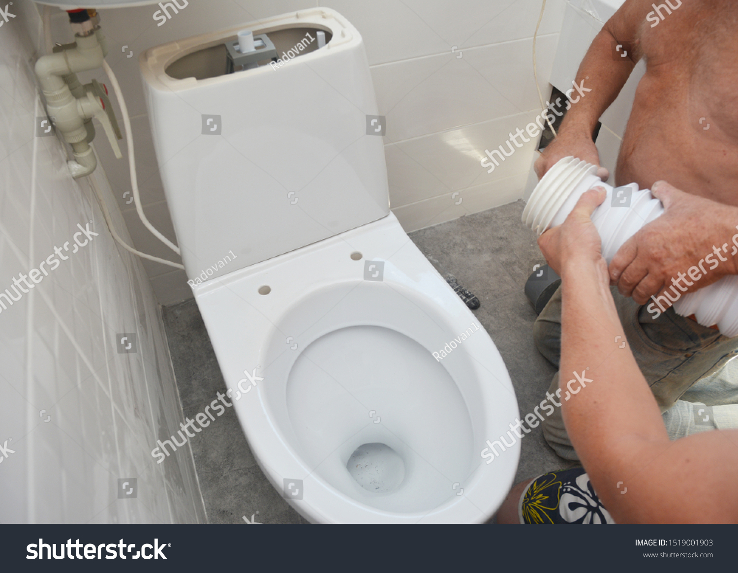 Repairman Installing Flush Toilet Toilet Bowl Stock Photo Edit Now 1519001903