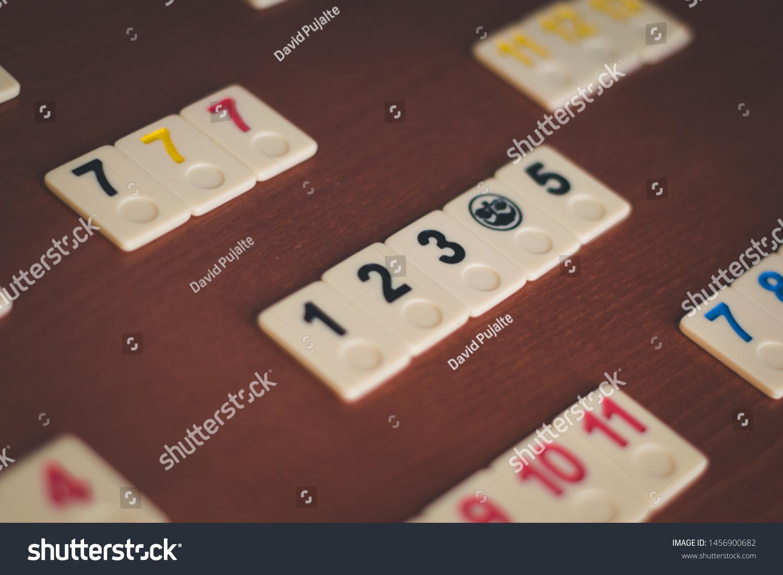 https www shutterstock com image photo rummikub board game tiles woodden table 1456900682