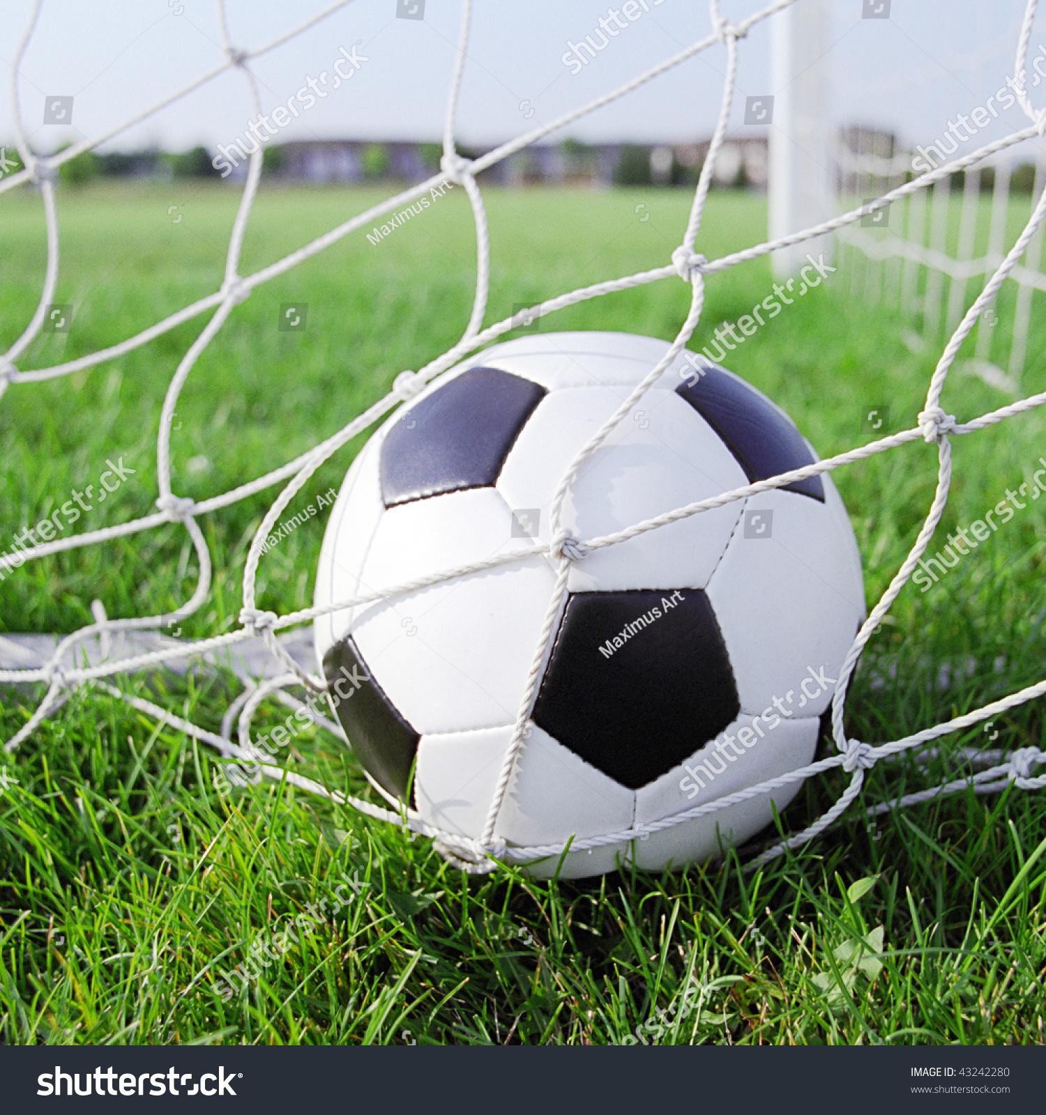 Soccer Ball In The Goal Net Stock Photo