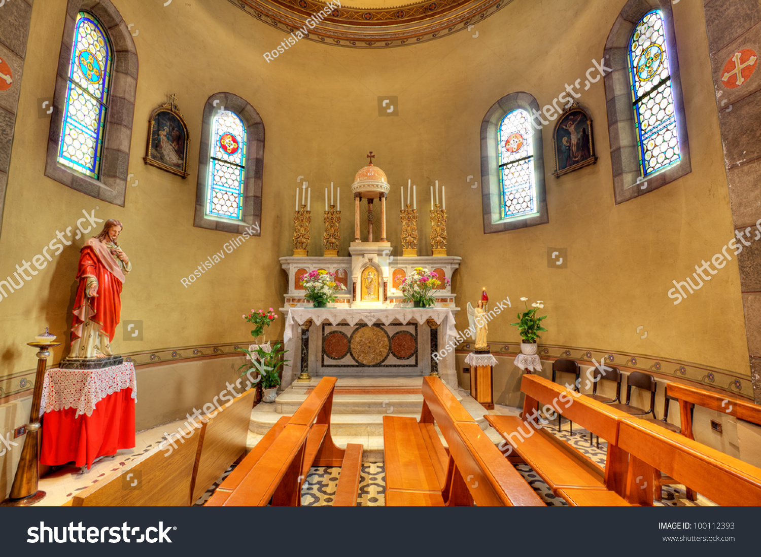 Statue Of Jesus And Altar As Part Of Interior View Of Catholic Church In Alba Northern Italy