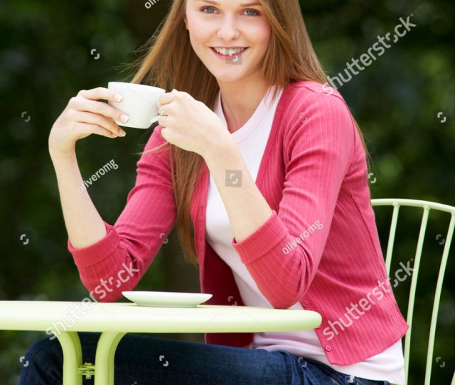 Teenage Girl With Hot Drink At Outdoor Cafe