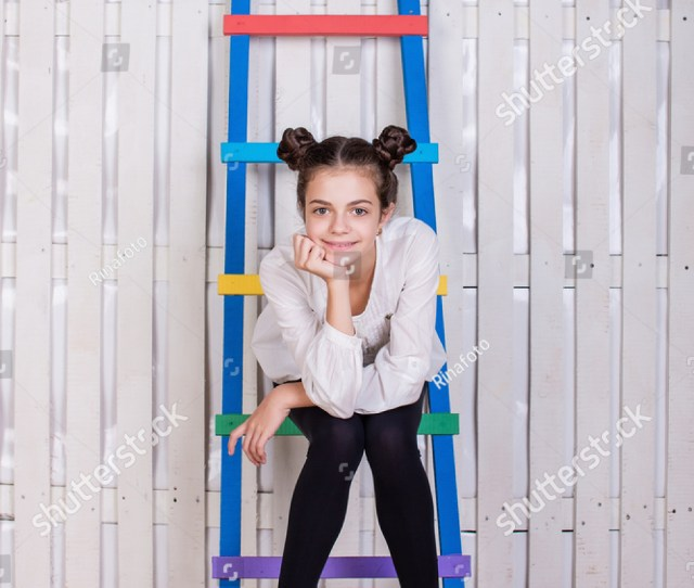 Young Beautiful Teen Girl Teenager School Girl Sitting On A Wooden Ladder On