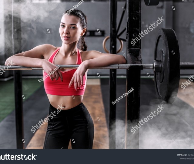 Young Girl In A Red Tube Top Is Posing With A Bar Bell In