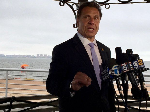 Gov. Andrew Cuomo speaks to the press on the FDR Boardwalk behind The Vanderbilt Tuesday after announcing a plan to widen the promenade atop a buried seawall. (Staten Island Advance/Rachel Shapiro)