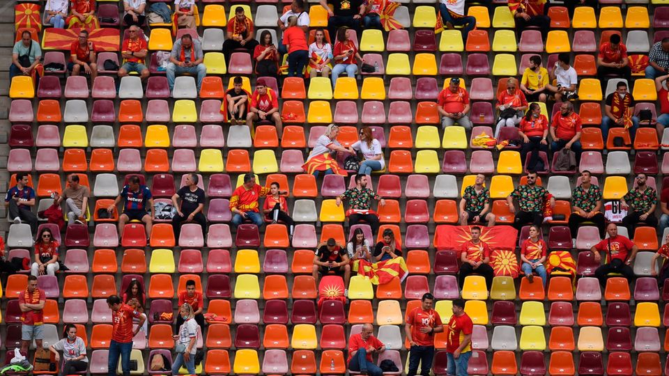 Fans of the North Macedonia team sit in Budapest Stadium