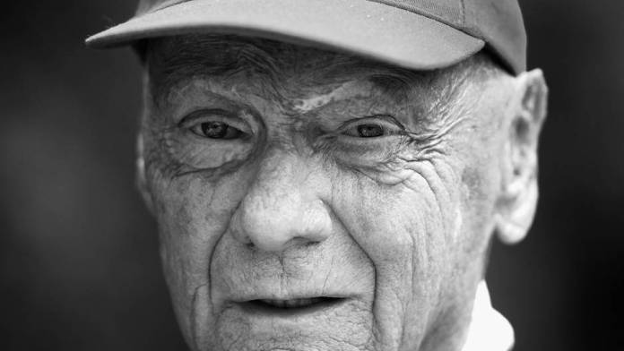 A black and white photo shows ex-Formula 1 driver Niki Lauda